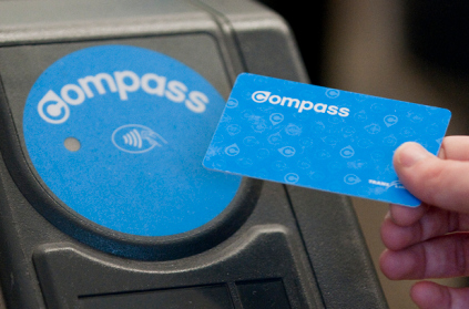 A beta tester uses a Compass card at Waterfront station.