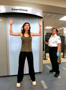 A model demonstrates a full body scanner in Phoenix, Ariz.