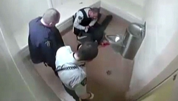 "Robert Wright on the cell floor after being ""taken to the ground"" by Terrace RCMP (Photo: screen cap from video provided by H. Prisk)"